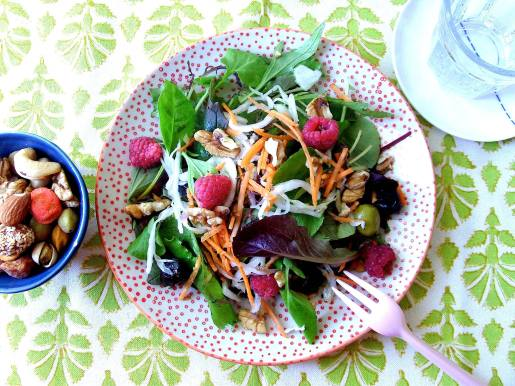 Fermented chou blanc and raspberry salad with a side of mixed nuts